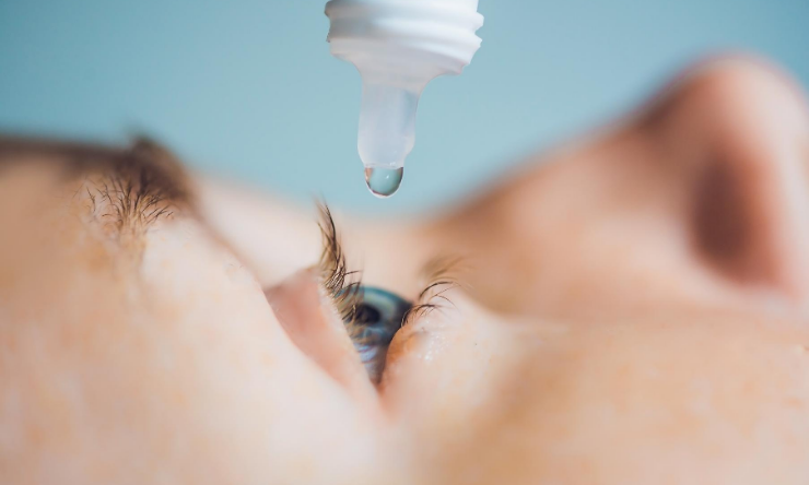 Image of an eye drop being administered to an eye