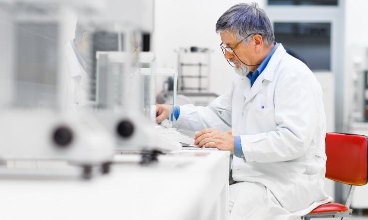 Male lab technician conducting test and recording data