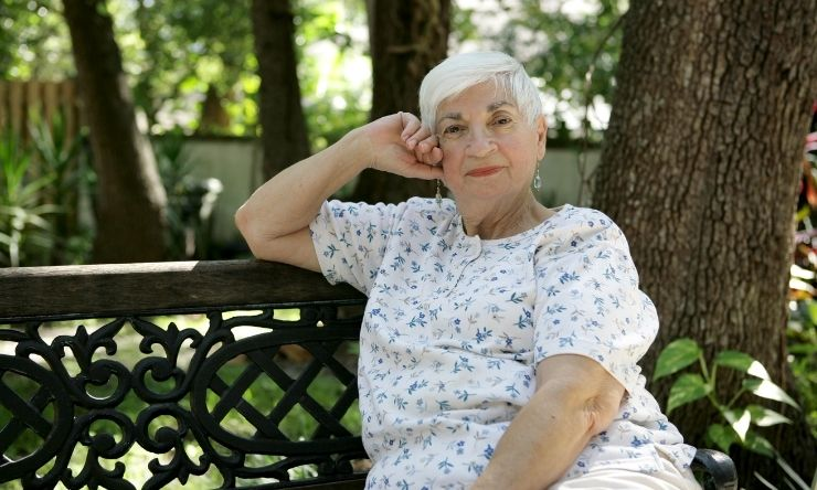 Older woman resting on park bench