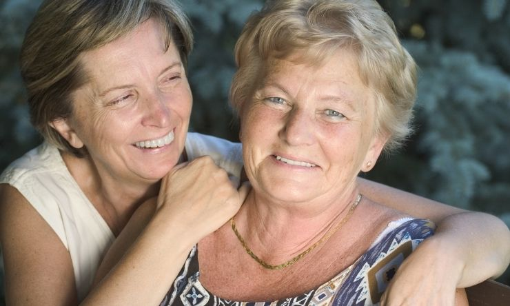 Two smiling middle aged women