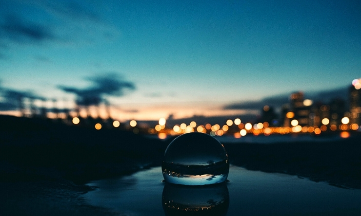 Image of crystal ball with evening twilight in background