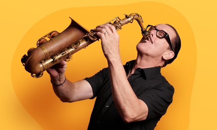 Image of Kirk Pengilly playing the saxophone