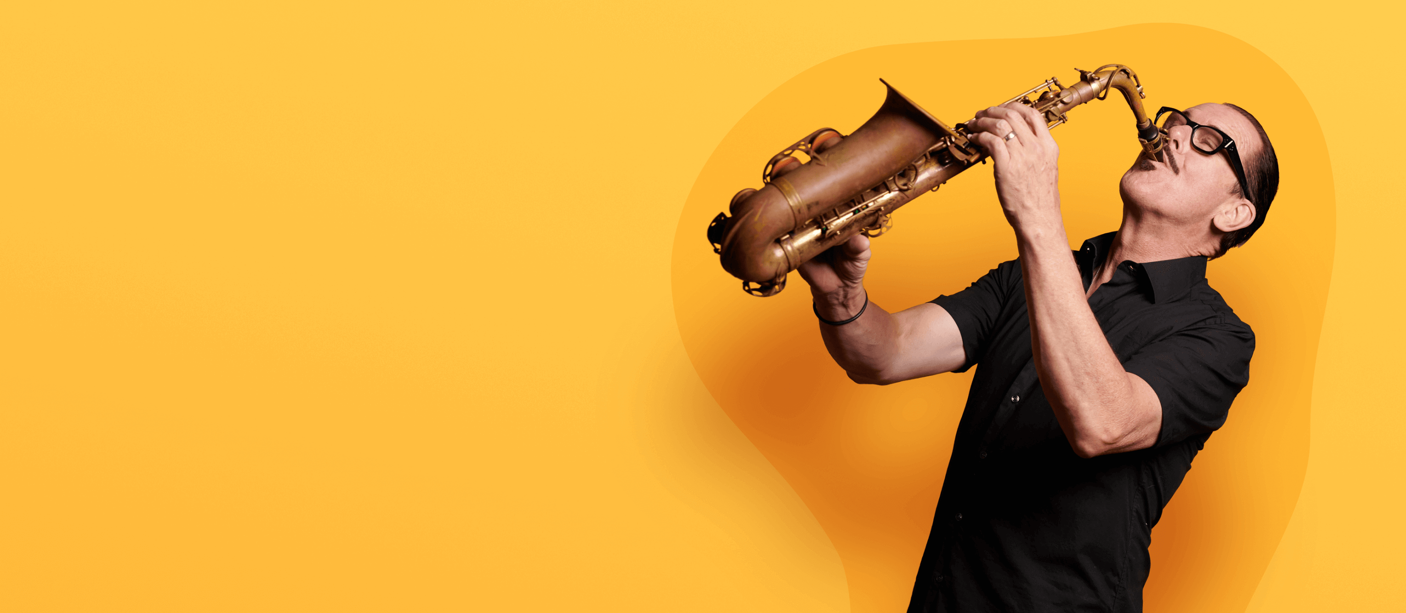 Image of Kirk Pengilly playing a saxophone with bright yellow background