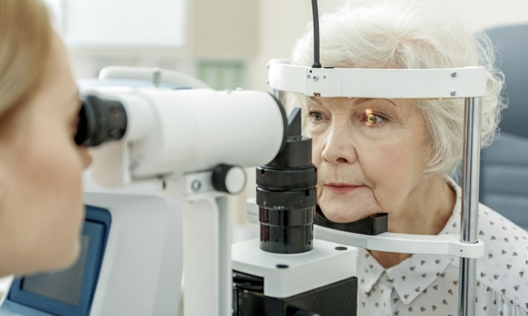 Image of older woman receiving an eye exam