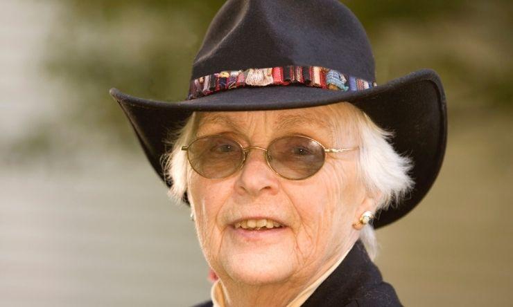 image of older lady wearing black akubra hat and sunglasses