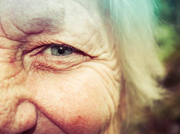 Close-up of a woman's eye with wrinkles