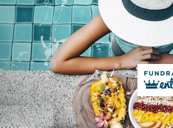 Woman with hat at poolside feast
