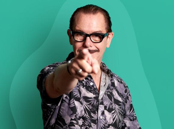 Image of Kirk Pengilly pointing at the camera