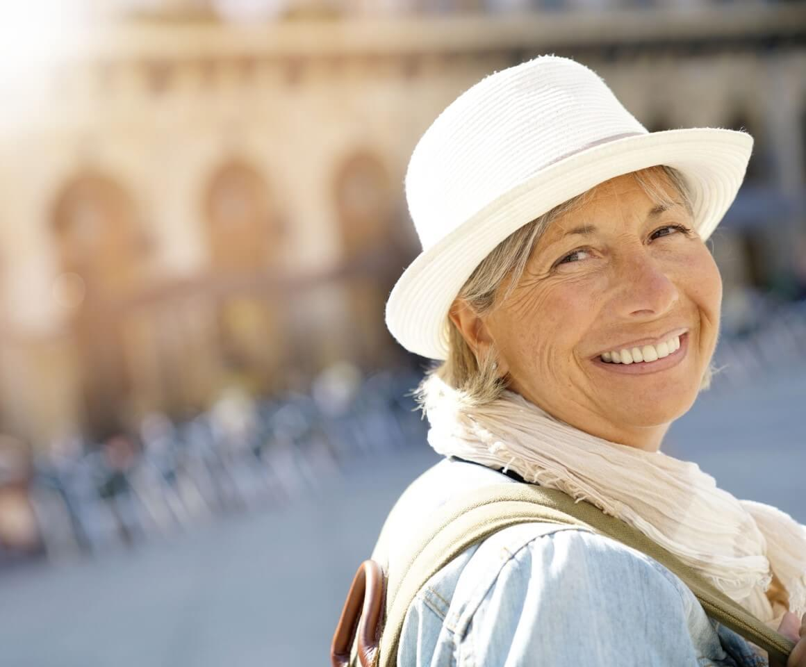 Lady in white summer hat smiling