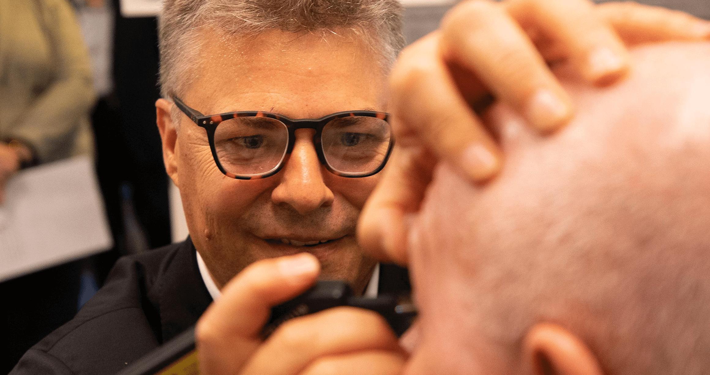 Prof Jamie Craig, examining a patient's eyes