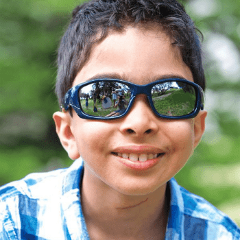 Young boy in checkered shirt wearing sunglasses