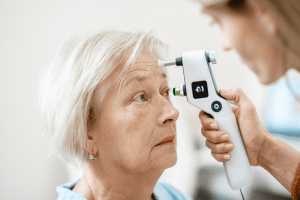 Female ophthalmologist measuring a patients eye pressure with a tonometer