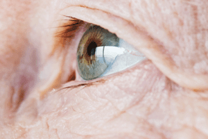 Close-up of an elderly man's eye surrounded by wrinkles